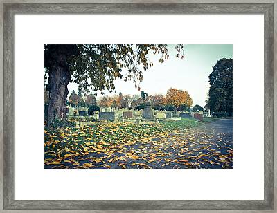 Cemetery In Autumn Framed Print by Tom Gowanlock