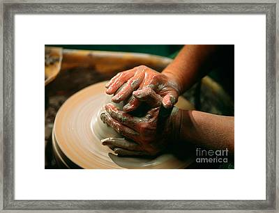 Centering Clay Framed Print by James L. Amos