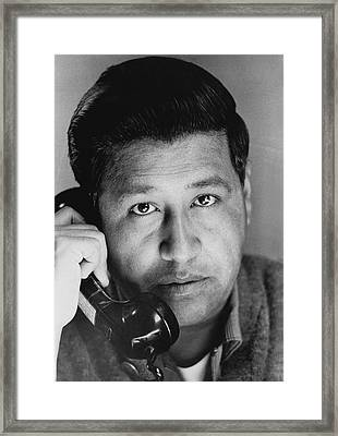 Cesar Chavez On The Phone Framed Print by Underwood Archives