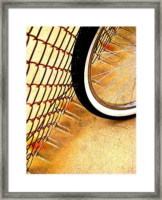 Chain Link Fence Scrapes Concrete Framed Print by John King