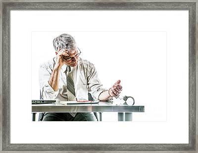 Chained To The Desk Framed Print