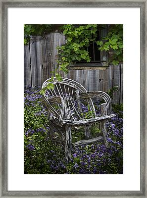 Chair In The Garden Framed Print by Debra and Dave Vanderlaan