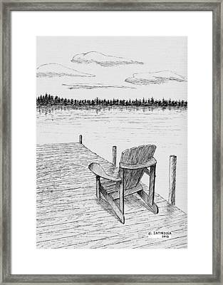 Chair On The Dock Framed Print