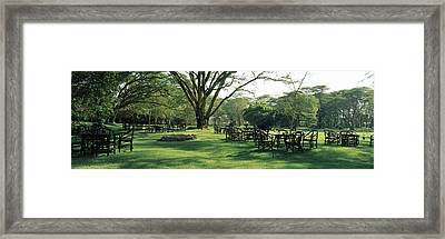 Chairs And Tables In A Lawn, Lake Framed Print
