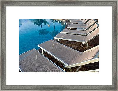 Chairs Around Hotel Pool Framed Print by Brandon Bourdages