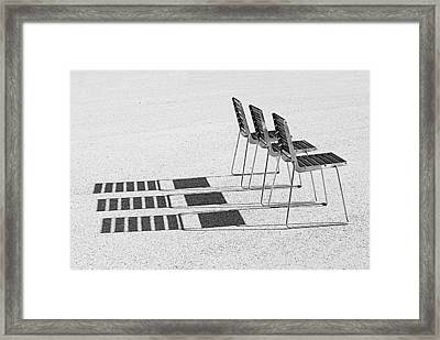 Chairs In The Sun Framed Print