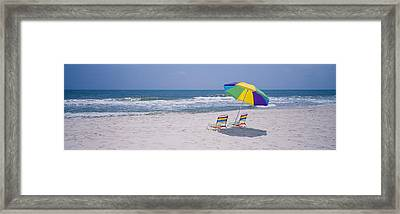 Chairs On The Beach, Gulf Of Mexico Framed Print by Panoramic Images