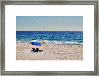 Chairs On The Beach With Umbrella Framed Print by Michael Thomas
