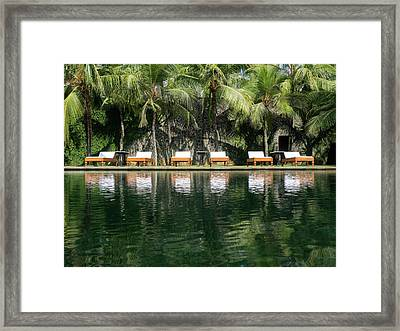Chaise Lounger Reflected In Pool Framed Print by Panoramic Images