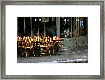 Chaises De Cafe Framed Print by John Rizzuto