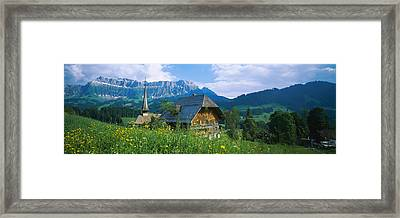 Chalet And A Church On A Landscape Framed Print by Panoramic Images