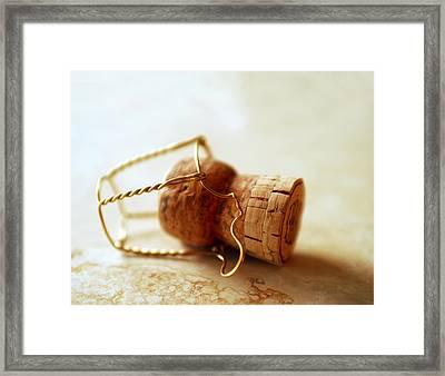 Champagne Cork Framed Print by Jon Neidert