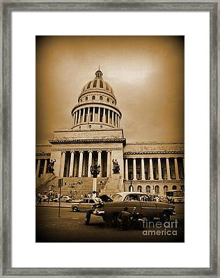 Changing A Tire In Front Of The Capitol Building In Havana Framed Print by John Malone