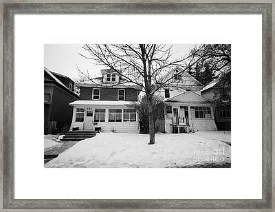 character homes during winter in caswell hill Saskatoon Saskatchewan Canada Framed Print by Joe Fox