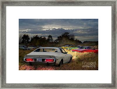 Charger Field Framed Print by Tom Straub