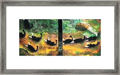 Charging Bulls Framed Print by Vickie Meza