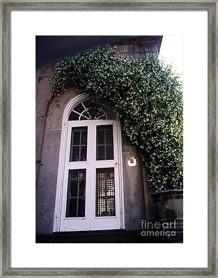 Charleston French Quarter White Door With Green Ivy Arch Framed Print by Kathy Fornal