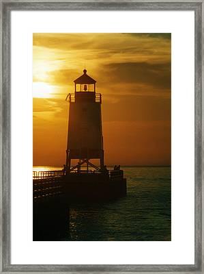 Charlevois Sunset Framed Print by Robert Lozen