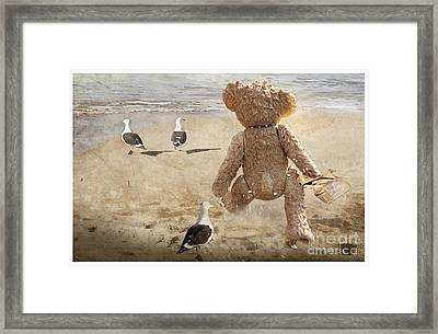 Chasing After Seagulls Framed Print by Adelita Rog