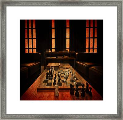 Checkmate Framed Print by Evelina Kremsdorf