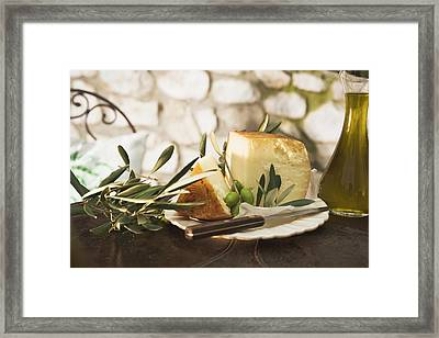 Cheese, Green Olives And Olive Oil On Table Out Of Doors Framed Print