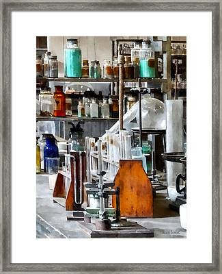 Chem Lab With Test Tubes And Retort Framed Print by Susan Savad