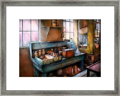 Chemist - Making Glue Framed Print by Mike Savad
