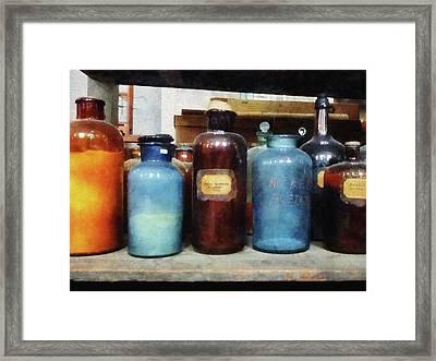 Chemist - Orange Brown And Blue Bottles Framed Print
