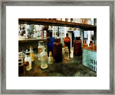 Chemistry - Assorted Chemicals In Bottles Framed Print by Susan Savad