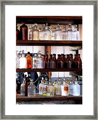 Chemistry - Bottles Of Chemicals On Shelves Framed Print