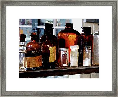 Chemistry - Brown Bottles Framed Print