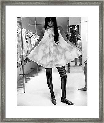 Cher Holding Out The Hem Of A Tent-shaped Dress Framed Print by Arnaud de Rosnay