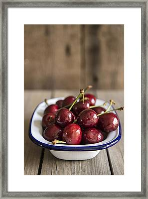 Cherries In Rustic Kitchen Setting With Wooden Background Framed Print by Matthew Gibson