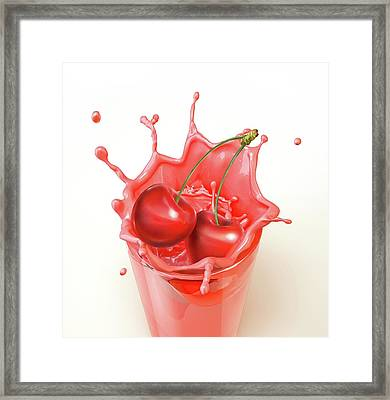 Cherries Splashing Into A Drink Framed Print by Leonello Calvetti