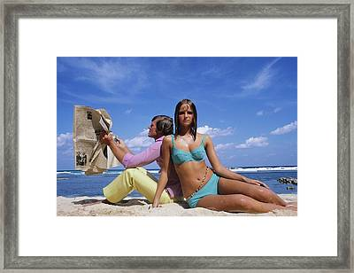 Cheryl Tiegs Modeling A Bikini At A Beach Framed Print by William Connors