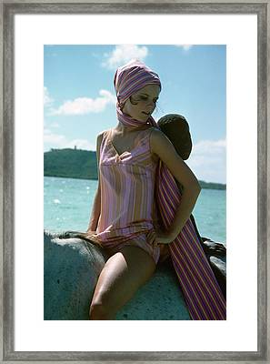Cheryl Tiegs Wearing A Striped Swimsuit Framed Print by Sante Forlano