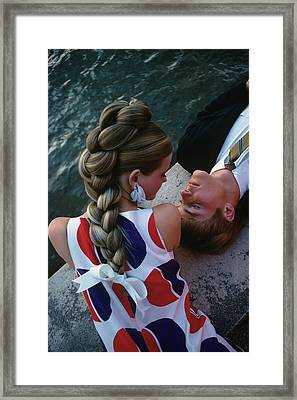 Cheryl Tiegs With A Male Model Framed Print by William Connors