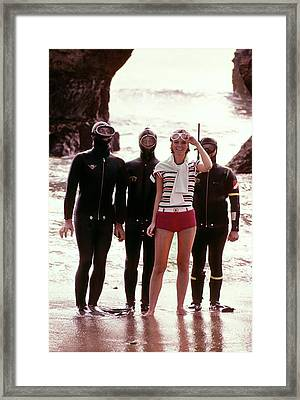 Cheryl Tiegs With Scuba Divers Framed Print by William Connors
