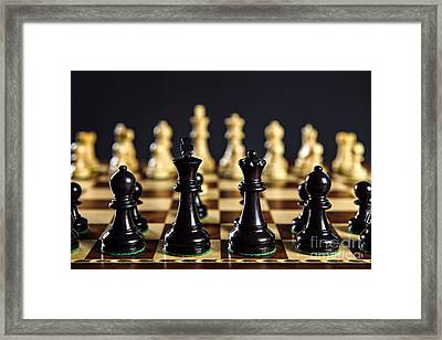 Chess Pieces On Board Framed Print by Elena Elisseeva