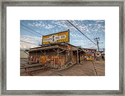 Chicken Oil Company Framed Print by Linda Unger