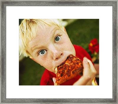 Child Eats Pizza Framed Print by Don Hammond
