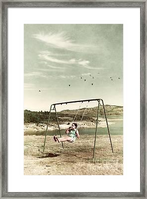 Child In A Swing Framed Print by Carlos Caetano