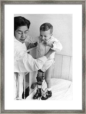 Child In Polio Ward Framed Print by Underwood Archives