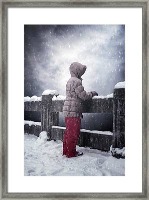 Child In Snow Framed Print by Joana Kruse