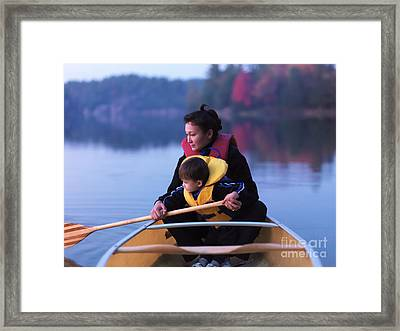 Child Learning To Paddle Canoe Framed Print by Oleksiy Maksymenko