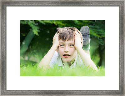 Child On The Grass Framed Print by Tom Gowanlock