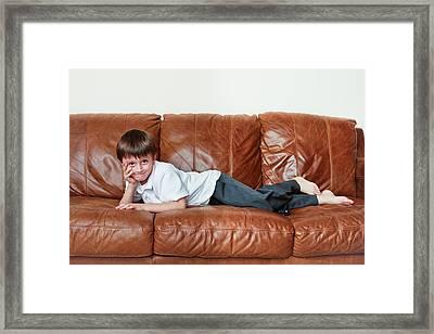 Child Relaxing Framed Print