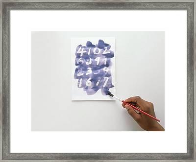 Child Using Paintbrush And Blue Ink Framed Print by Dorling Kindersley/uig