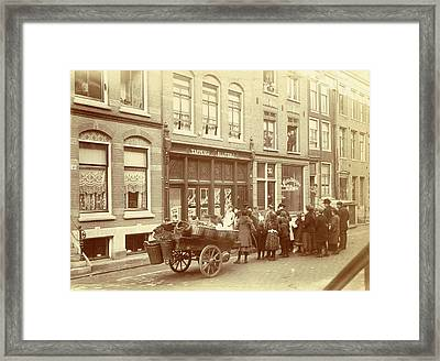 Children And Adults Watch The Work For A Liquor Store Framed Print