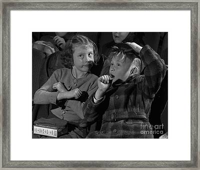 Children At A Film Matinee In 1946 Framed Print
